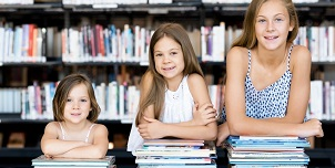 Little girls reading books in library 2.jpg