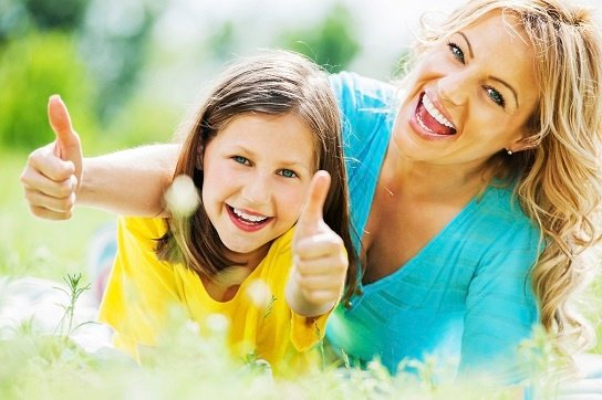Mother and daughter thumbs up.jpg