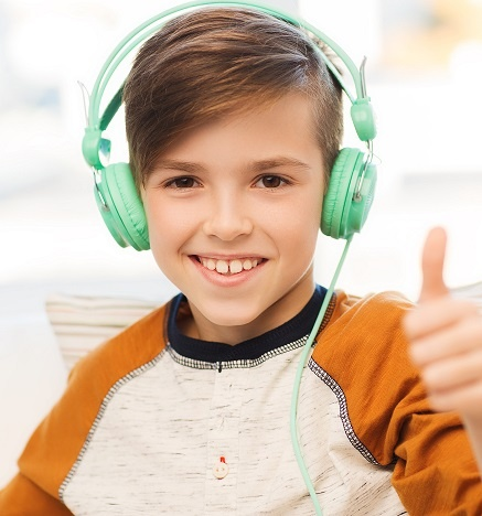 boy headphones thumbs up.jpg