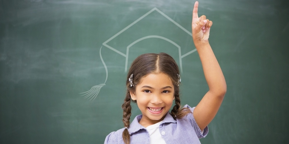 Graduation hat vector against smiling pupil raising her hand-822561-edited.jpeg